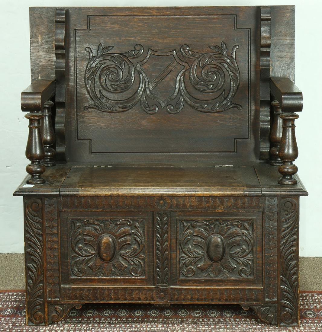 Gothic Revival oak monk's bench, circa 1870, having a