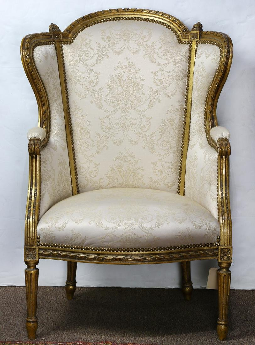Louis XV style giltwood carved wing back bergere,
