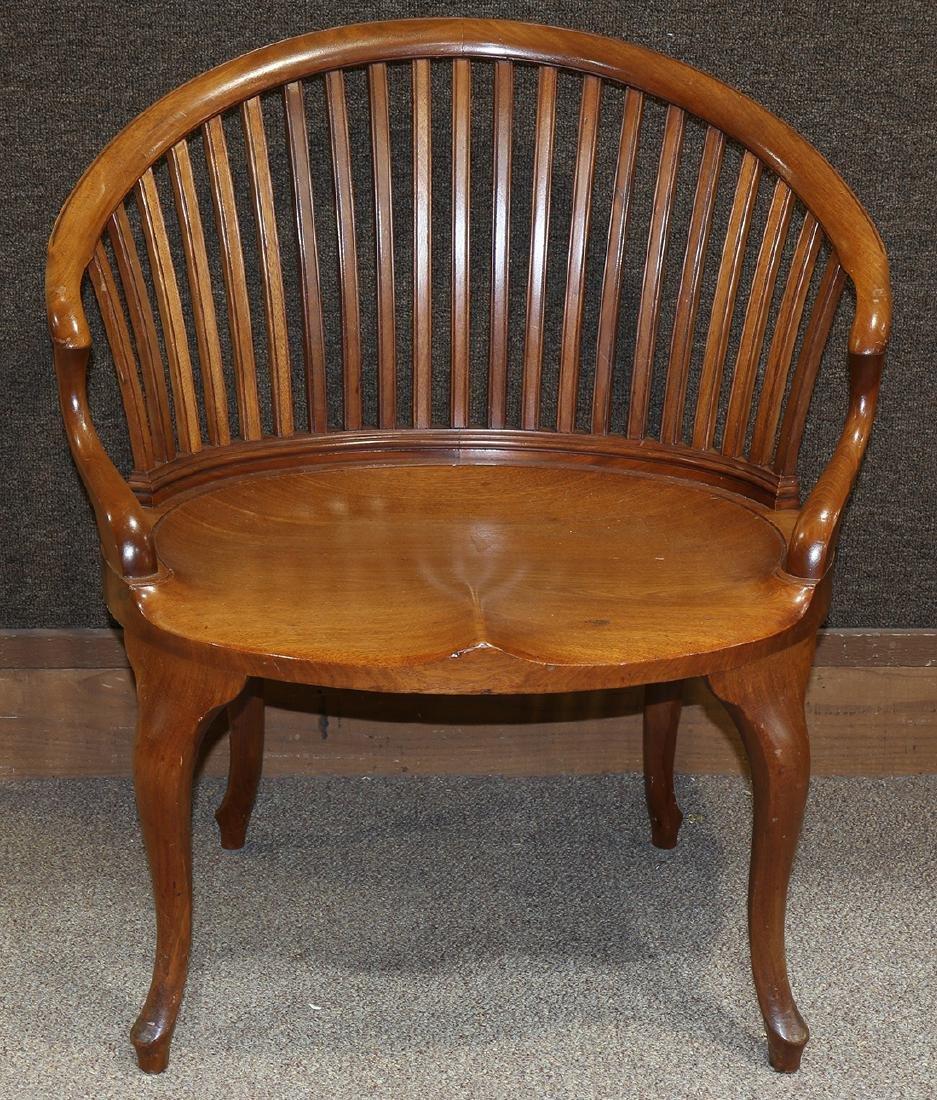 Mid Century walnut barrel chair