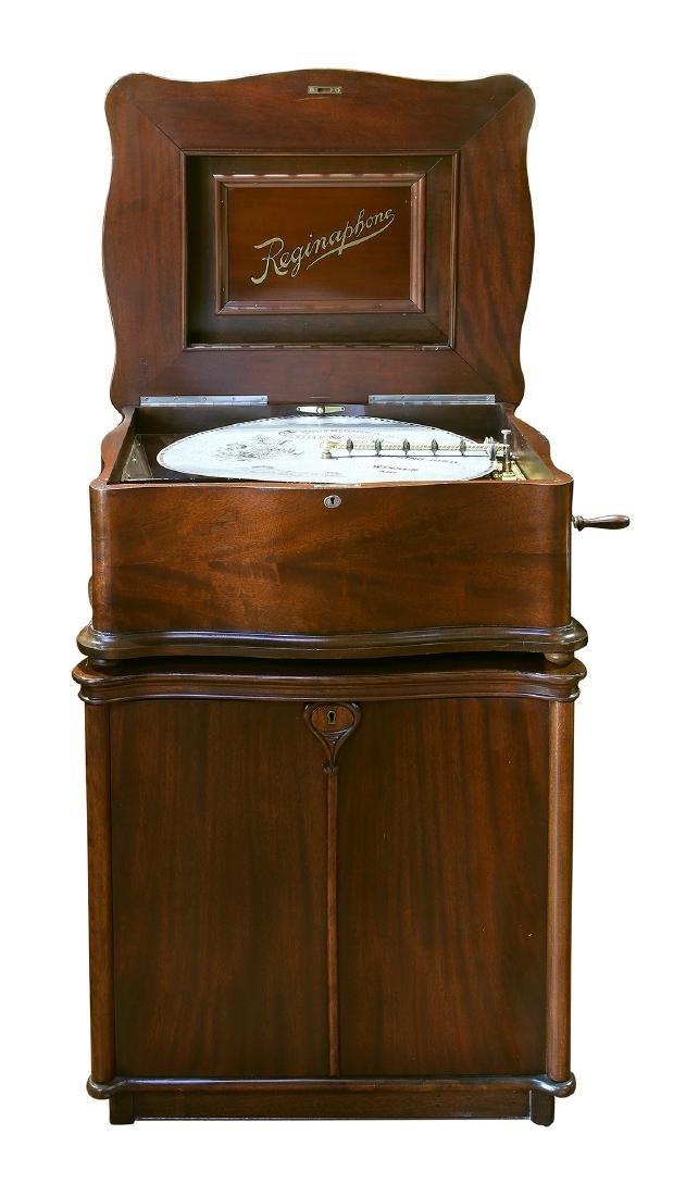 "Reginaphone upright music box playing 21"" discs"