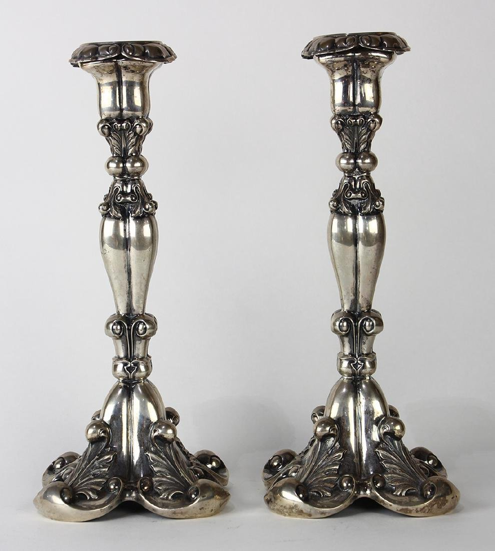 Pair of Continental Rococo-style silver candle holders