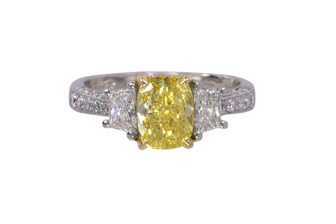Natural fancy vivid yellow diamond, near colorless