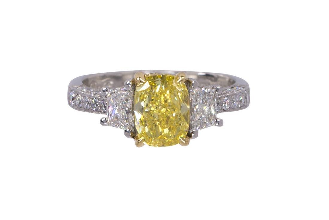Natural fancy vivid yellow diamond, near colorless