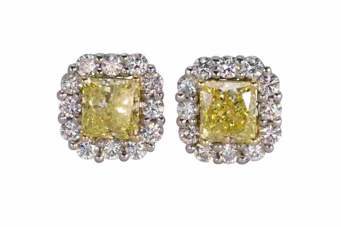 Pair of natural fancy intense yellow diamond, near