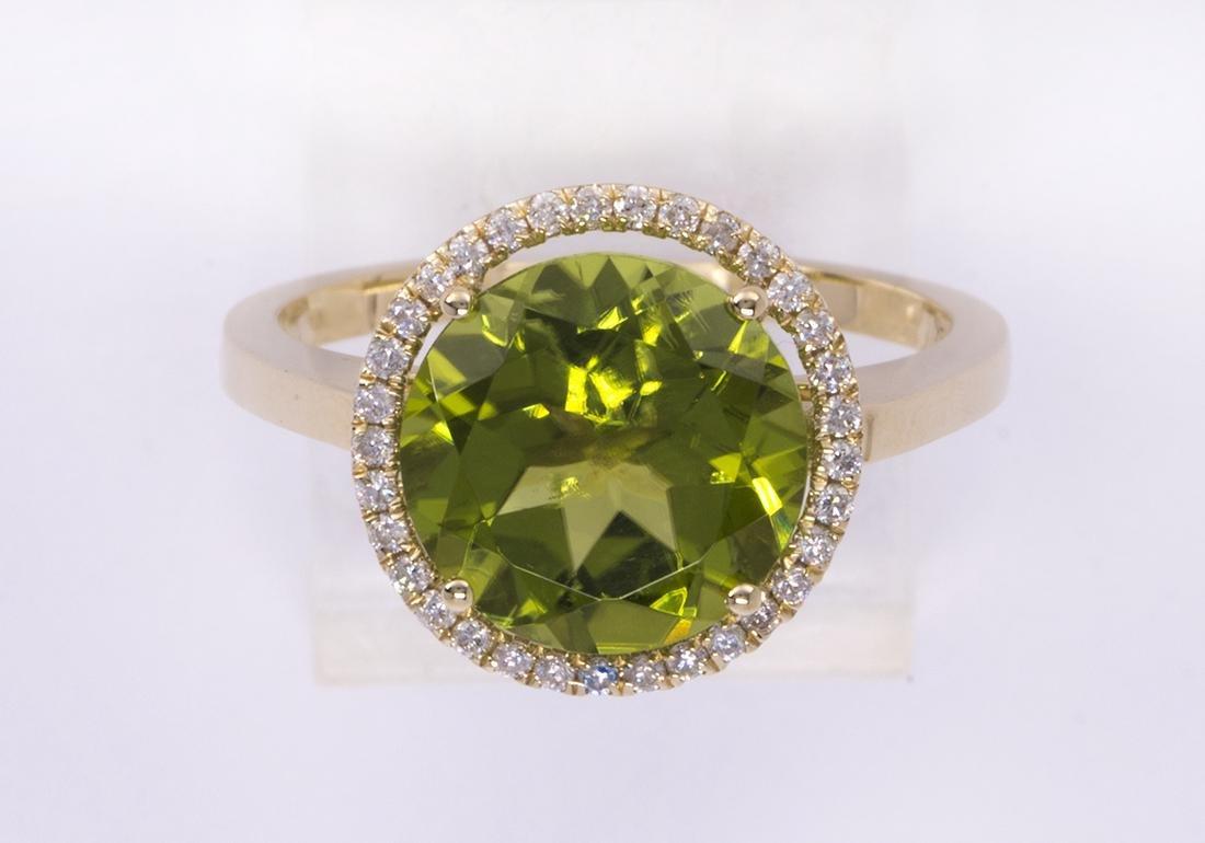 Peridot, diamond and 14k yellow gold ring