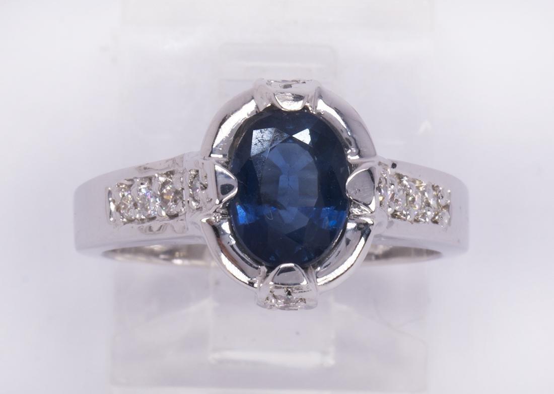Sapphire, diamond and 14k white gold ring