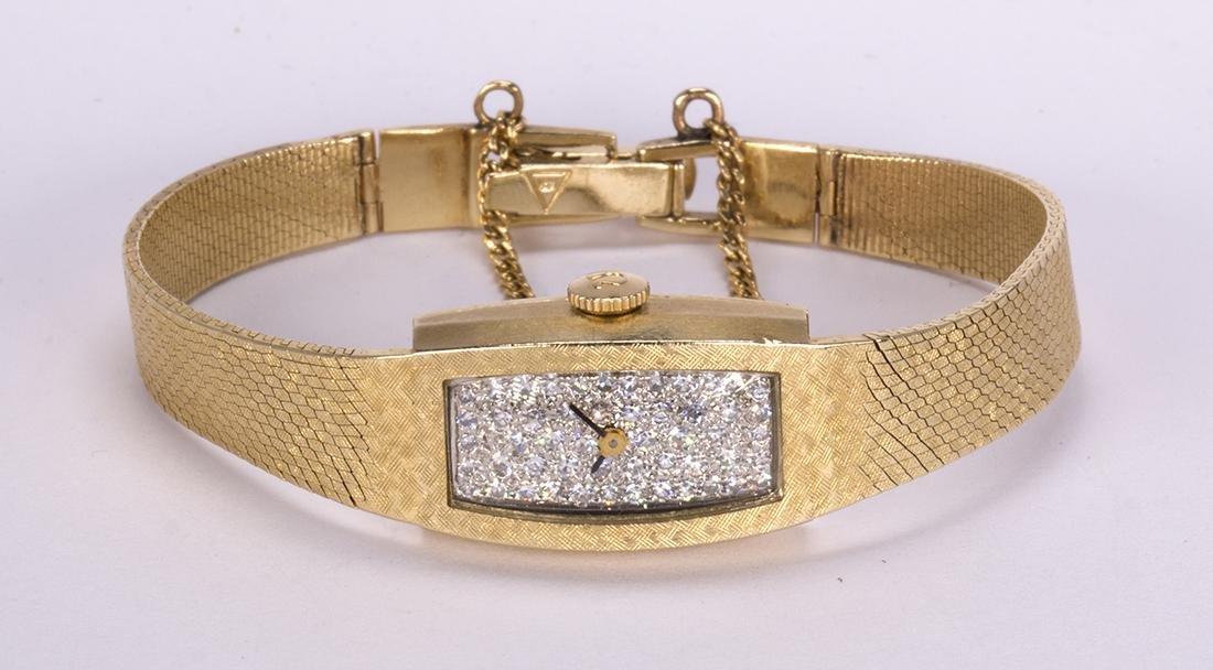 Lady's Omega diamond and 14k yellow gold wristwatch