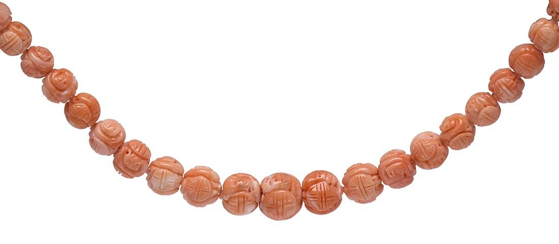 Carved coral bead and metal necklace