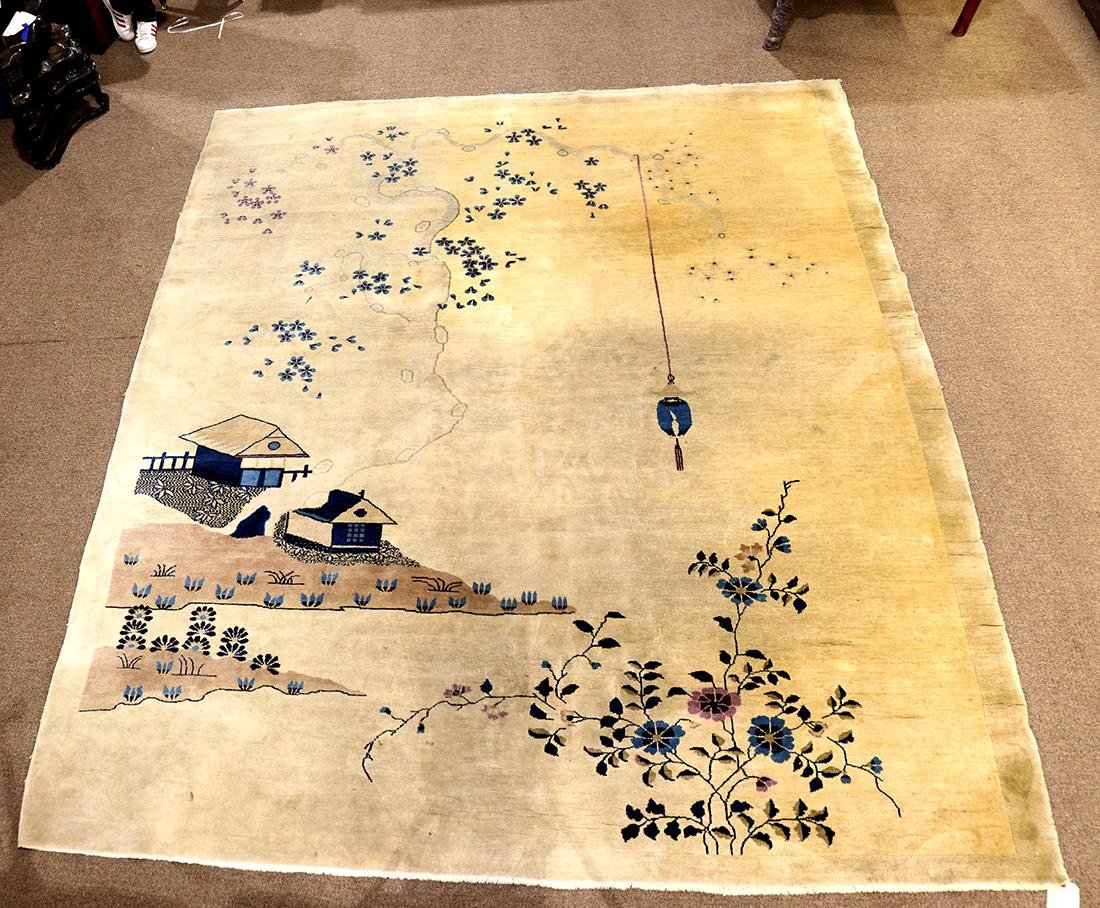 Chinese area rug, depicting a landscape with houses,