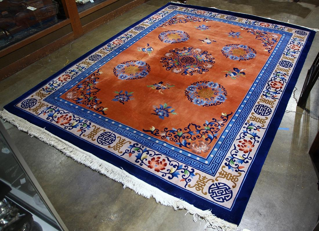 Chinese orange and blue rug with flowers and shou