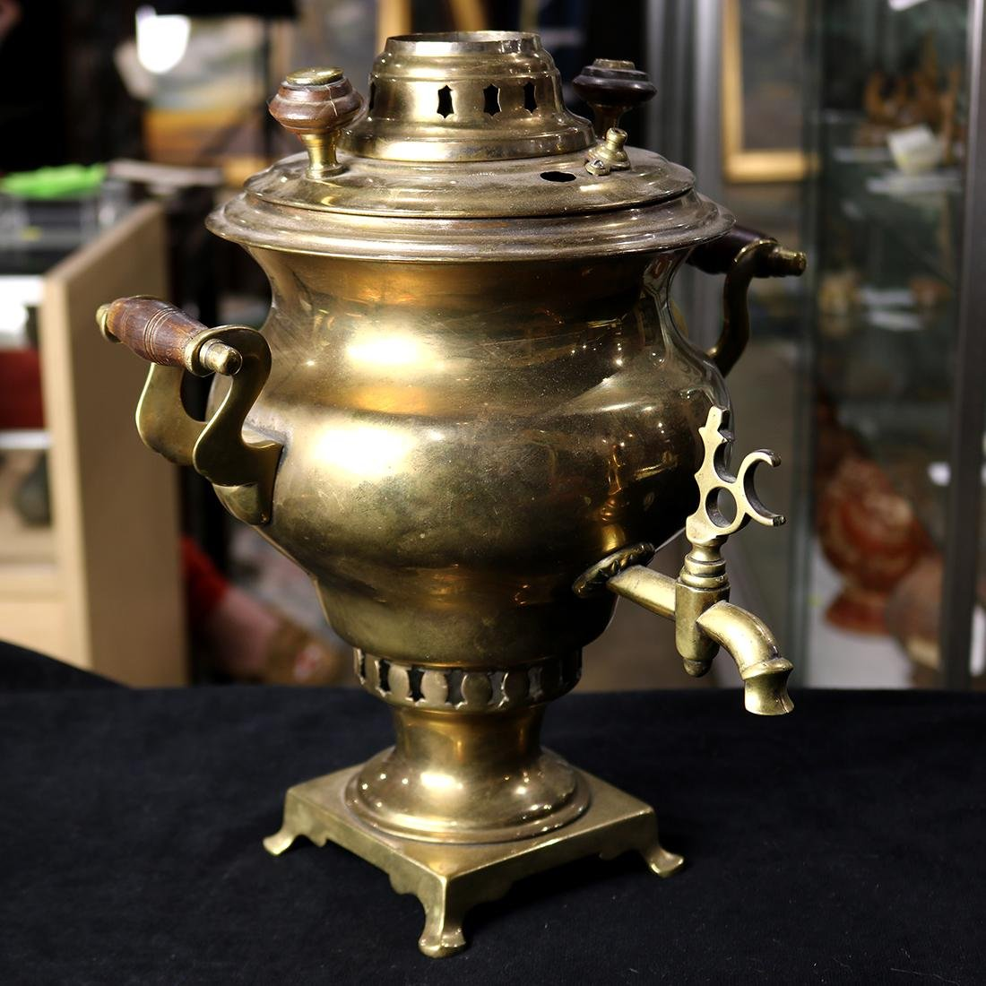 Brass Samovar, the ovoid form flanked by wood turned