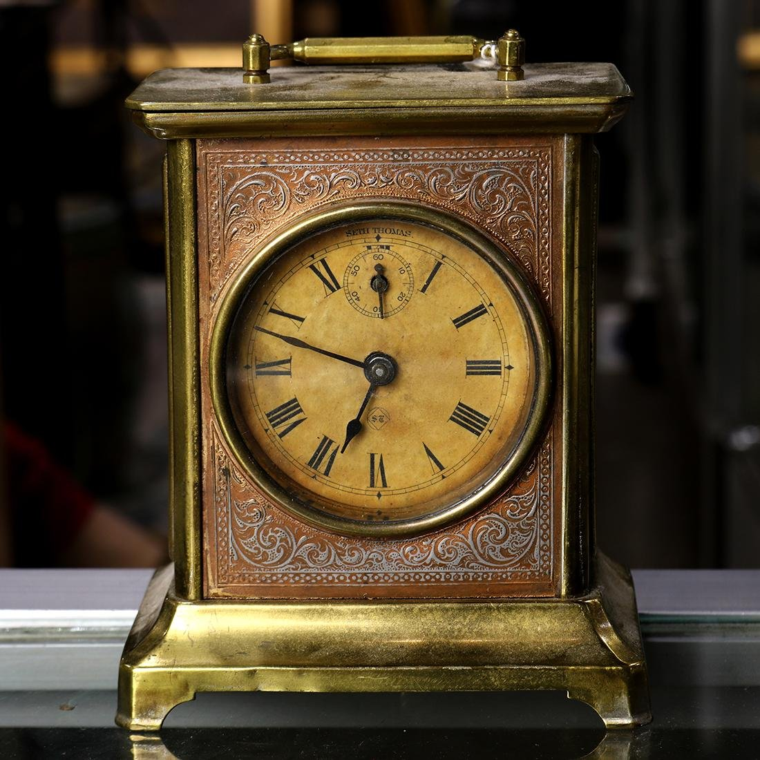 Seth Thomas brass and copper carriage clock, the round