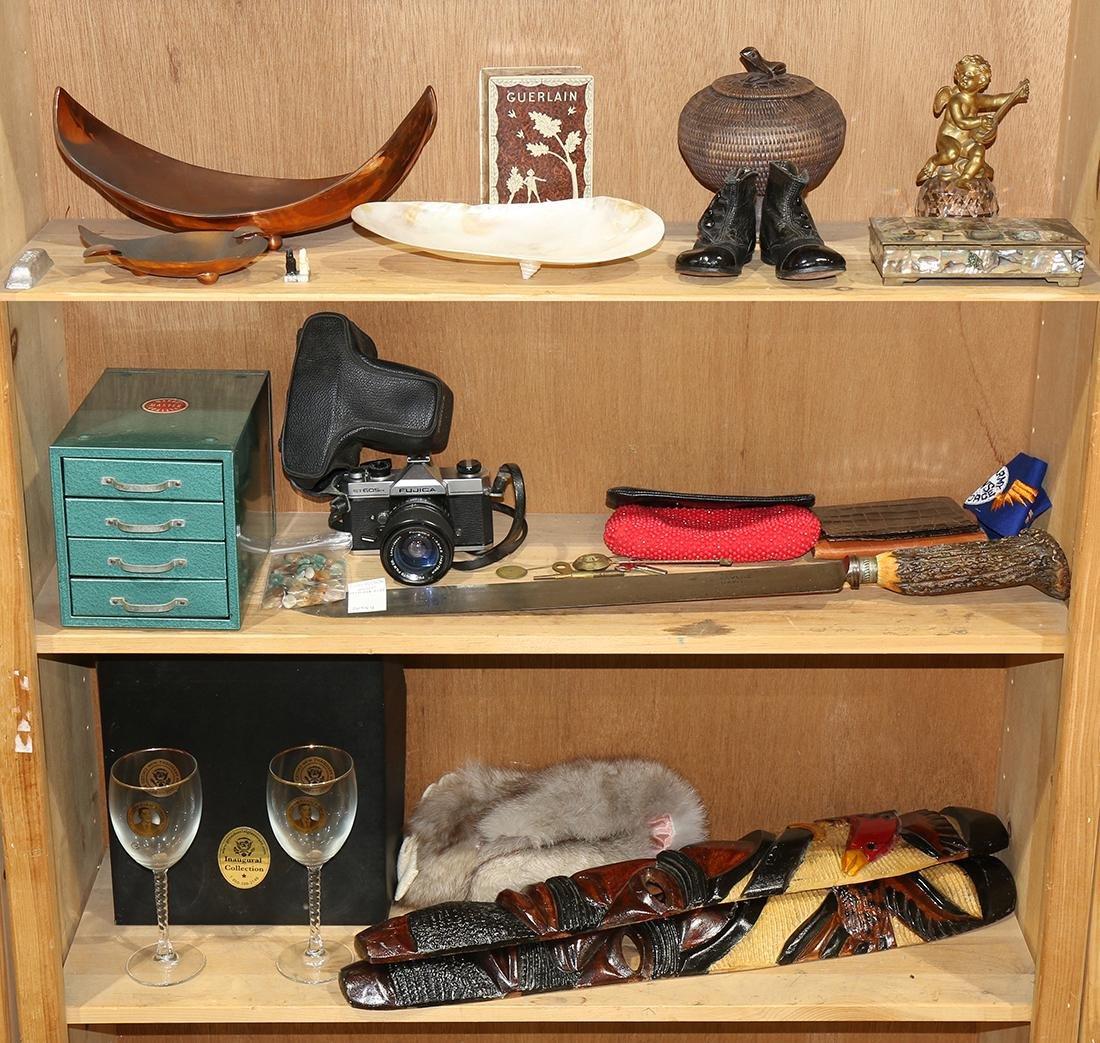 Three shelves of associated decorative art including