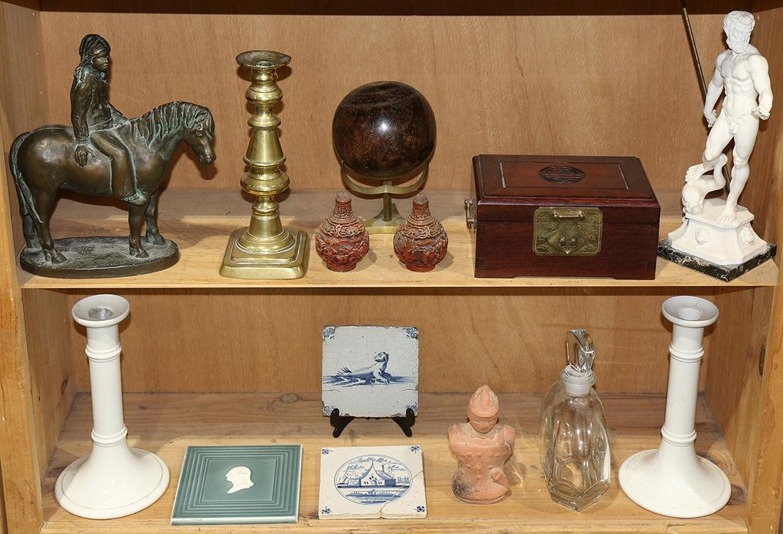 Two shelves of miscellaneous decoratives, including