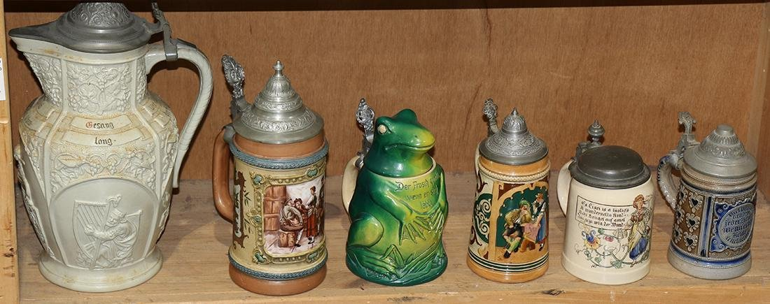 One shelf of German stoneware steins, each polychrome
