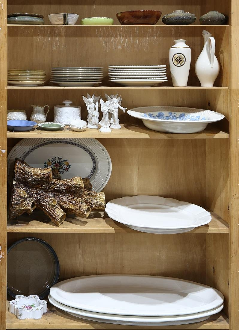 Five shelves of decorative porcelain and ceramic table