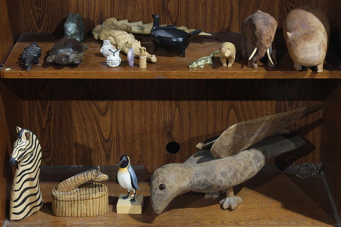 Two shelves of associated decoratives