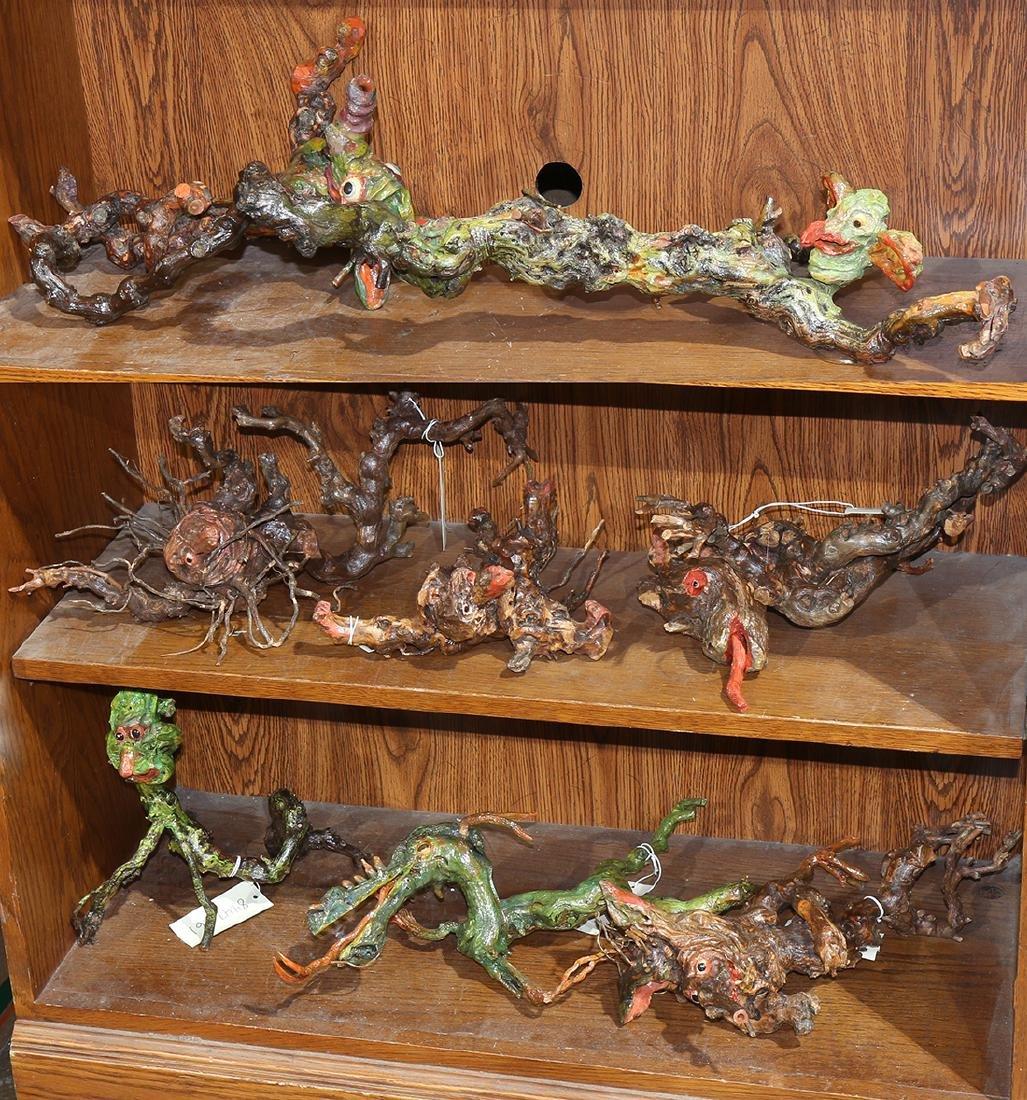 Three shelves of brutalist grape vine sculptures, each