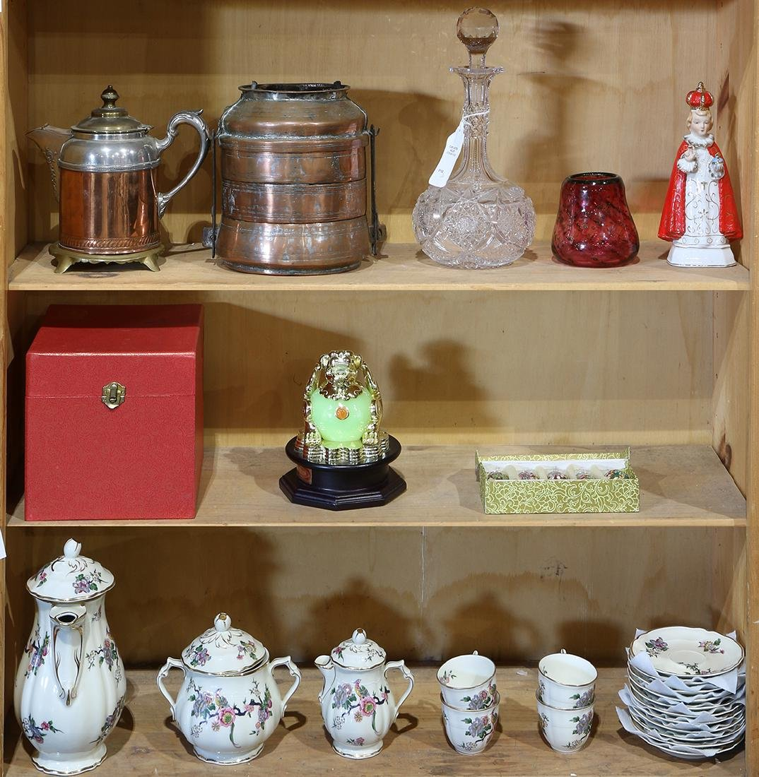 Three shelves of miscellaneous decoratives, consisting