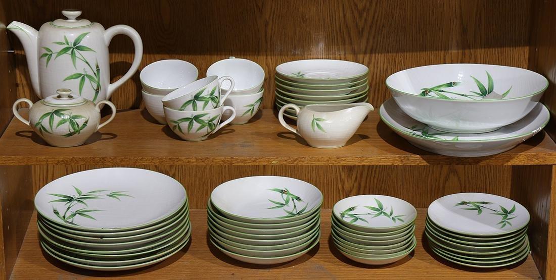 Two shelves of Bamboo Japanese porcelain dinner service