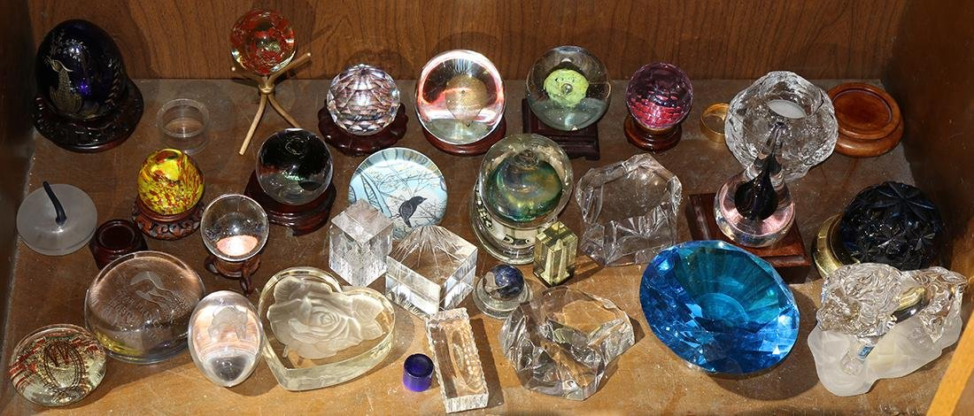 One shelf of glass paperweights, including an examples