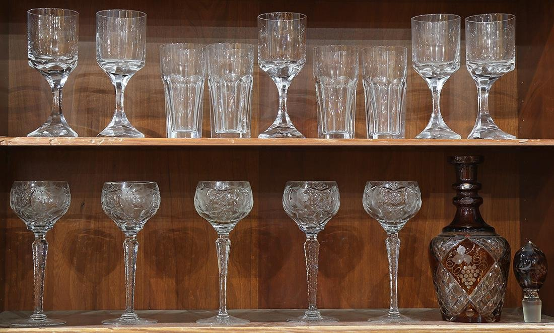Two shelves of Baccarat stemware, including (5) faceted