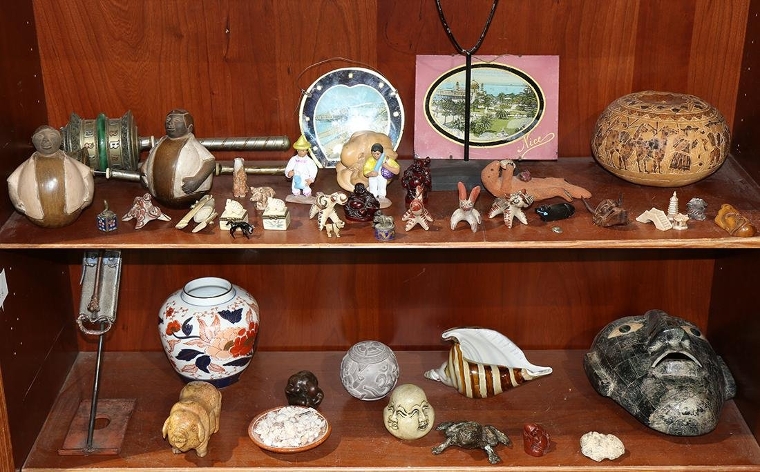 Two shelves of associated decoratives and fetishes