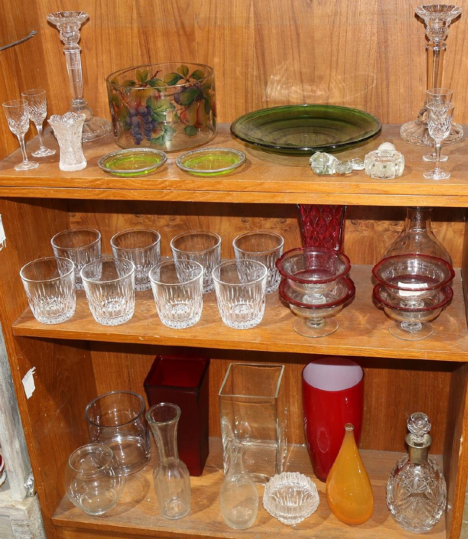 Three shelves of glass table articles, consisting of