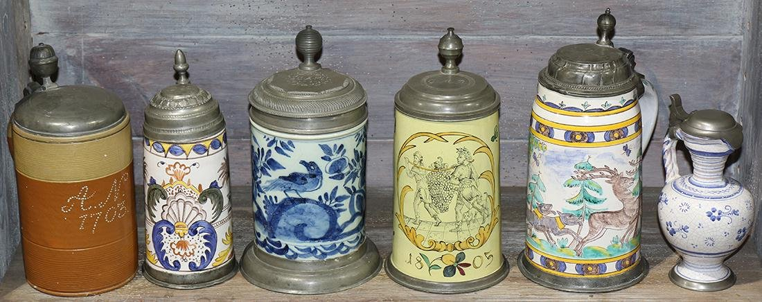 One shelf of ceramic steins