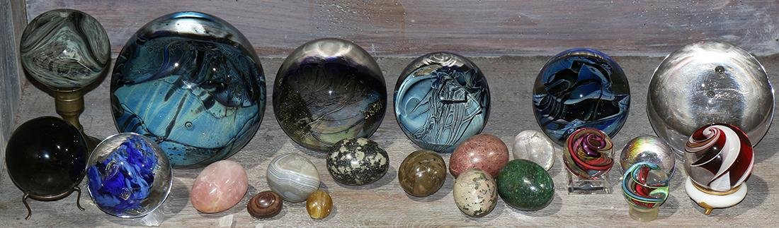 One shelf of art glass and stone carved paperweights,