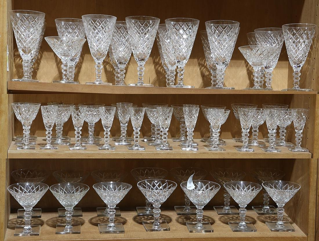 Three shelves of Hawkes crystal stemware