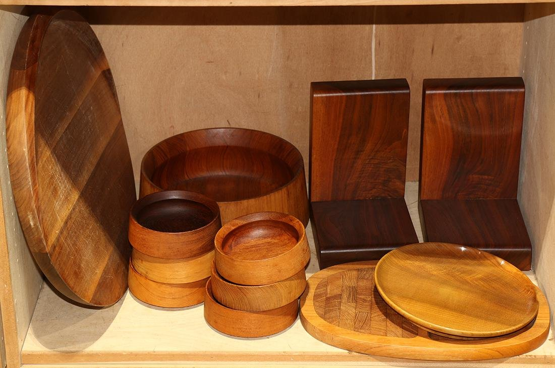 One shelf of Dansk wood turned table articles, mostly