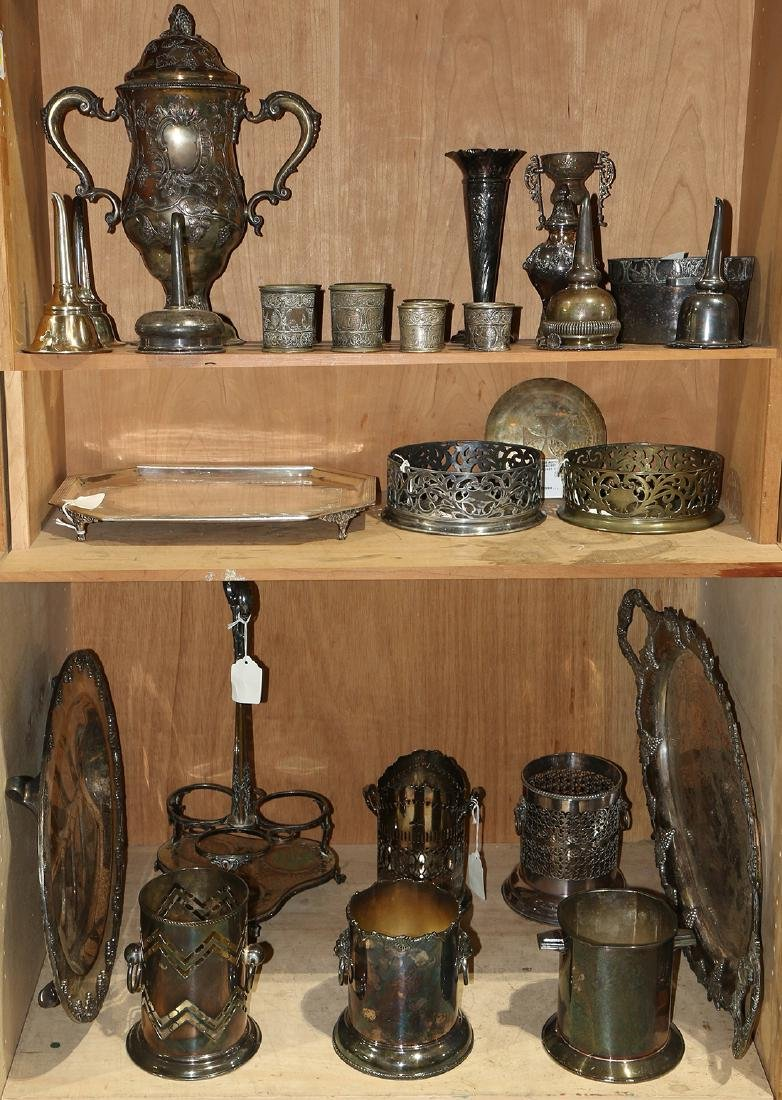 Three shelves of silver plate articles