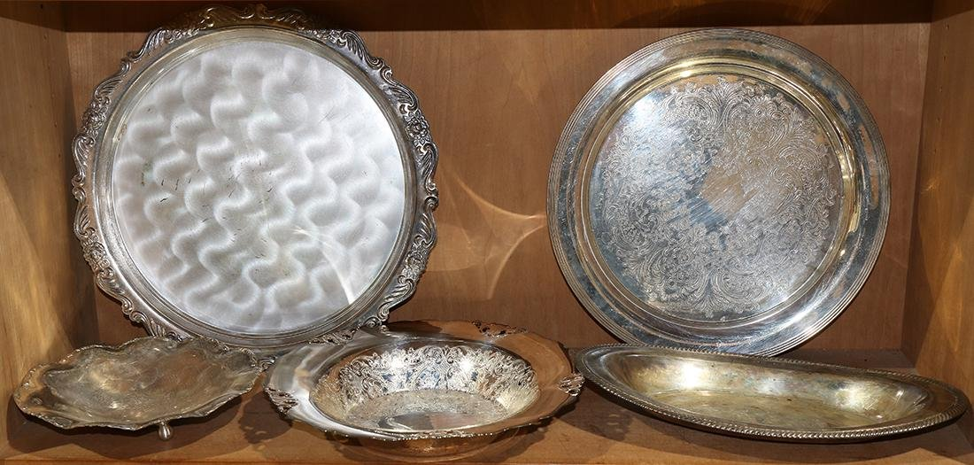 One shelf of silver plate serving trays