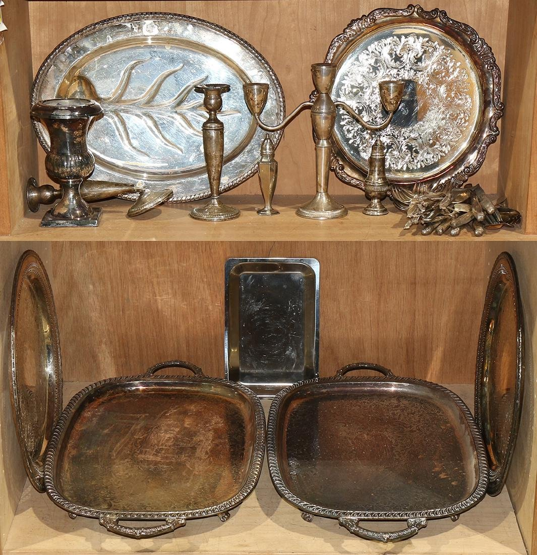 Two shelves of decorative art including silver plate