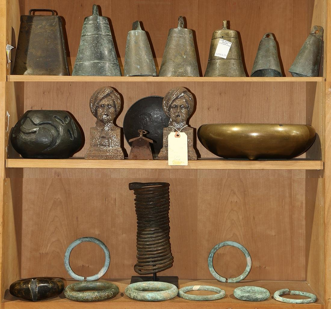 Three shelves of decorative art including Chinese