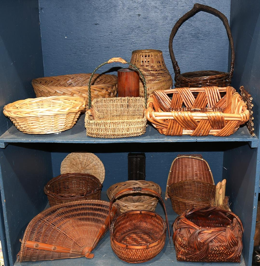 Two bins of woven basketry, mostly Asian and South-East