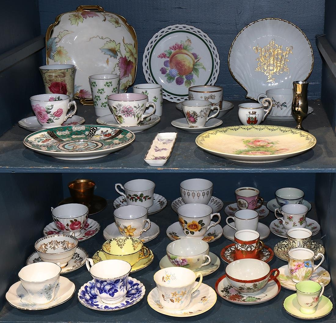 Two bins of decorative art including assorted tea cups
