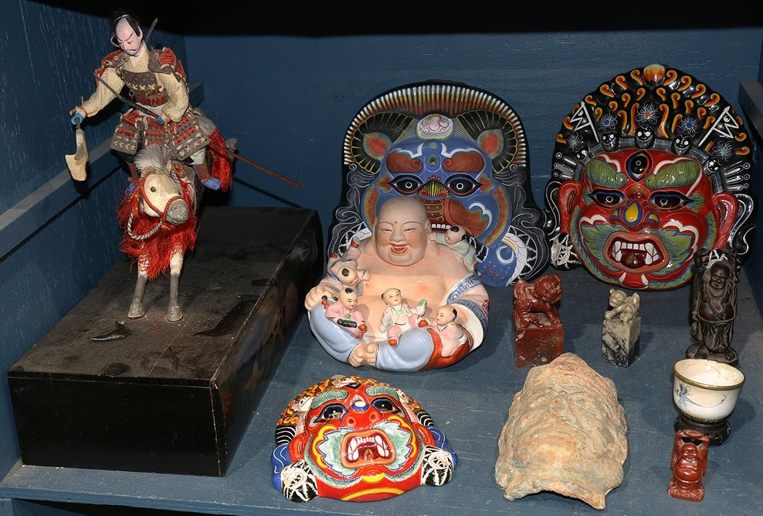One bin of decorative Asian art, including a figural