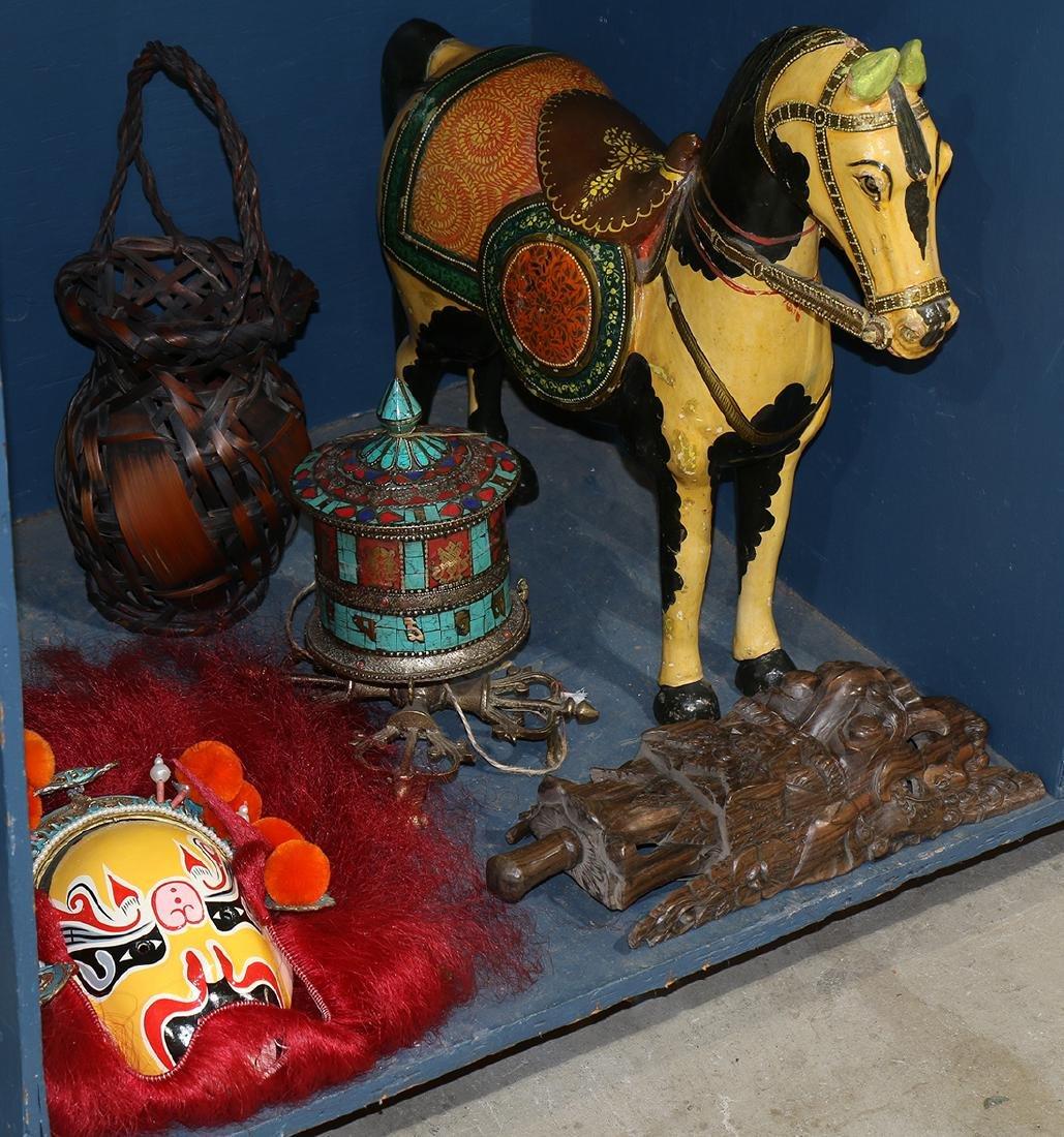 One bin of decorative Asian art