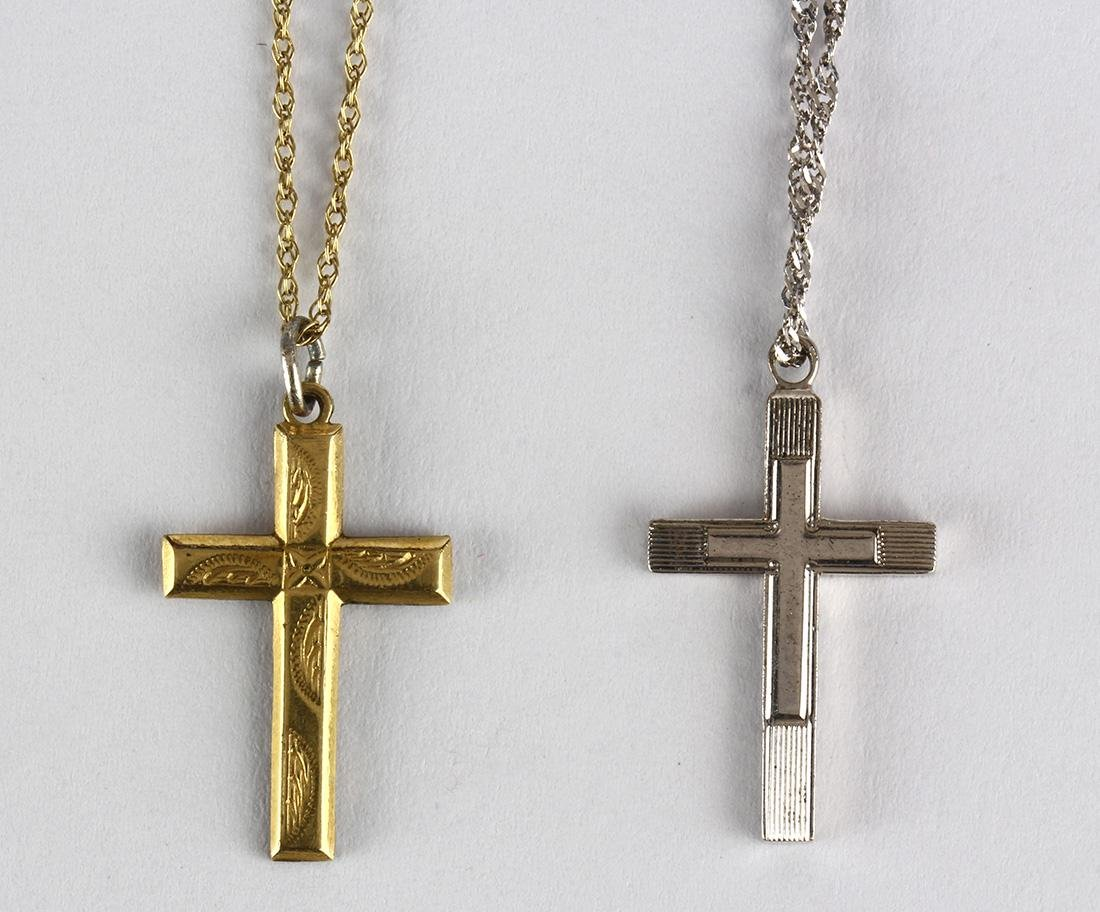 (Lot of 2) Yellow gold and sterling silver cross