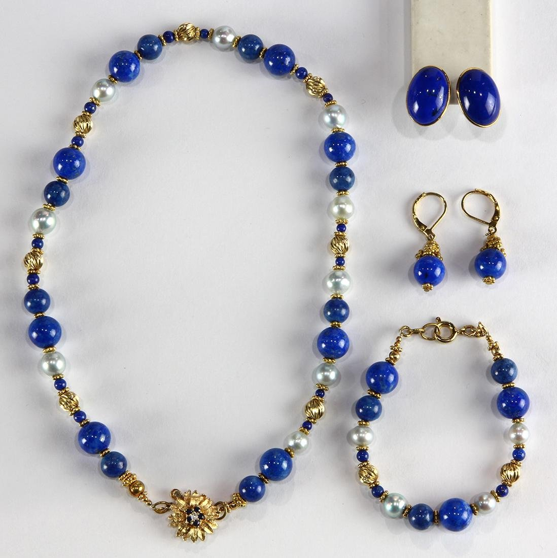 (Lot of 4) Lapis lazuli, cultured pearl and yellow gold