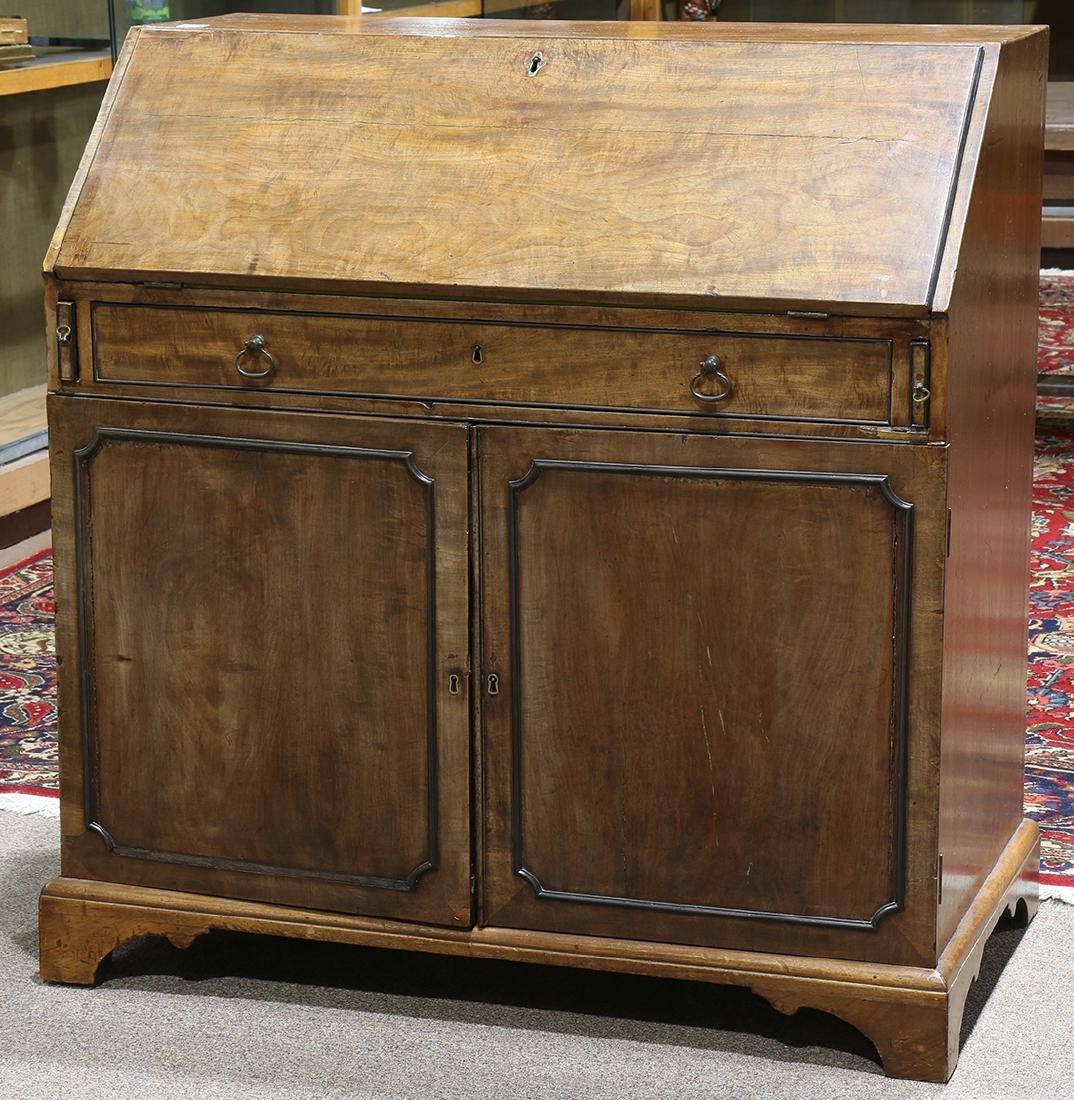 Georgian slant front desk, having a hinged front,