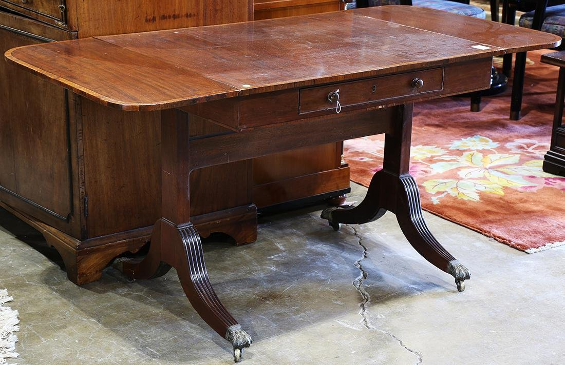 Regency-style drop leaf library table, having a
