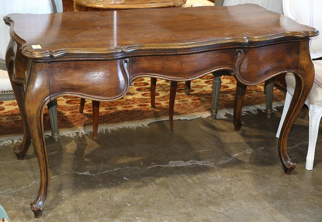 French Provincial style writing desk, having a shaped