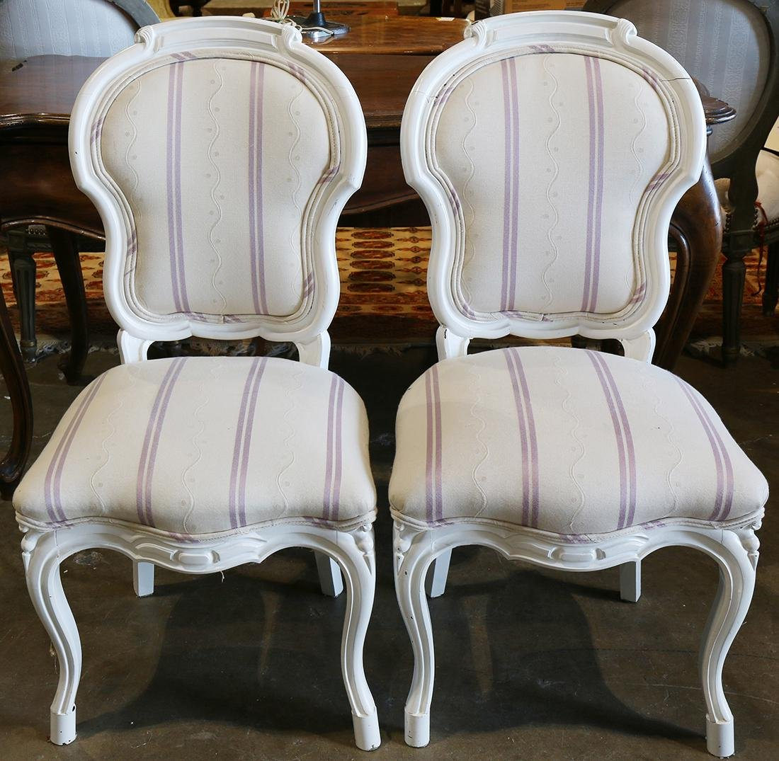 Pair of Rococo style side chairs, having a white