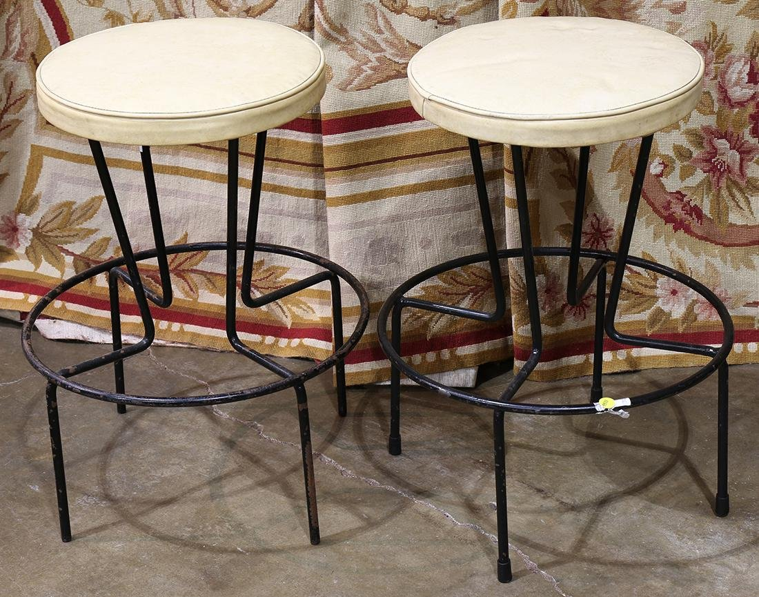 Pair of Mid-Century modern stools, each with an