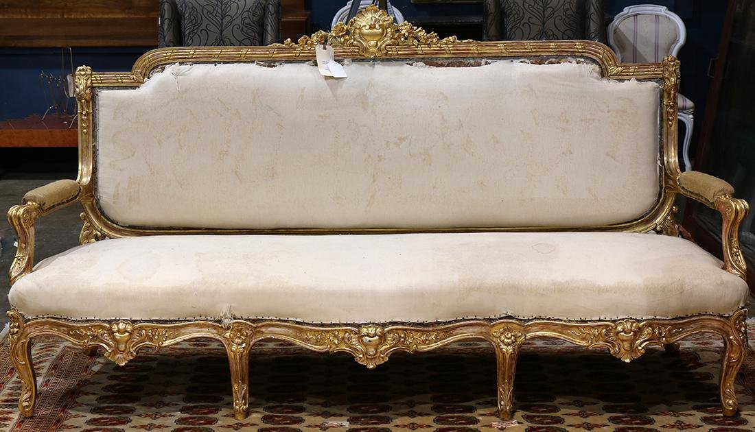 French Louis XVI style gilt parlor sofa, having an