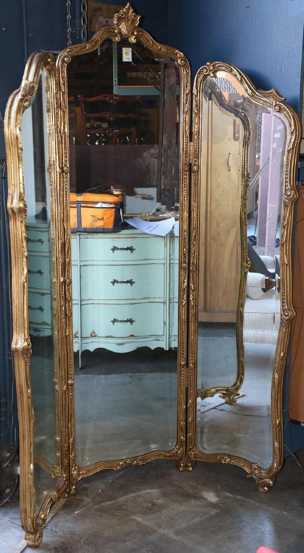 Rococo style gilt composite trifold mirror, having