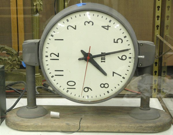 182: Double sided, electric wall clock IBM